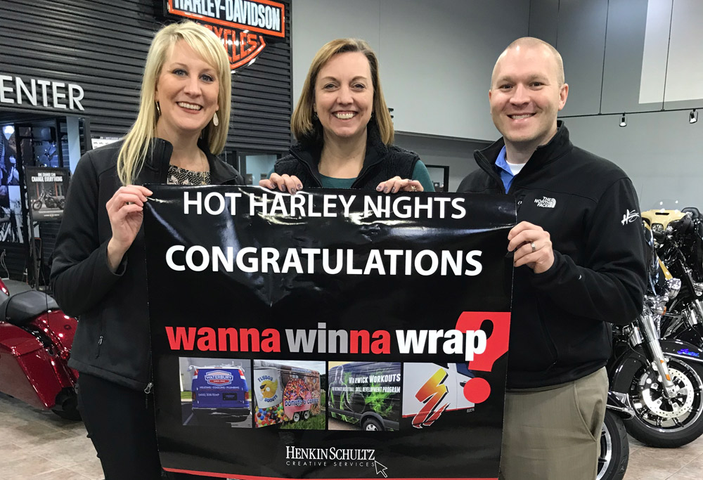 Hot Harley Nights staff getting notification they won Wanna Winna Wrap contest.