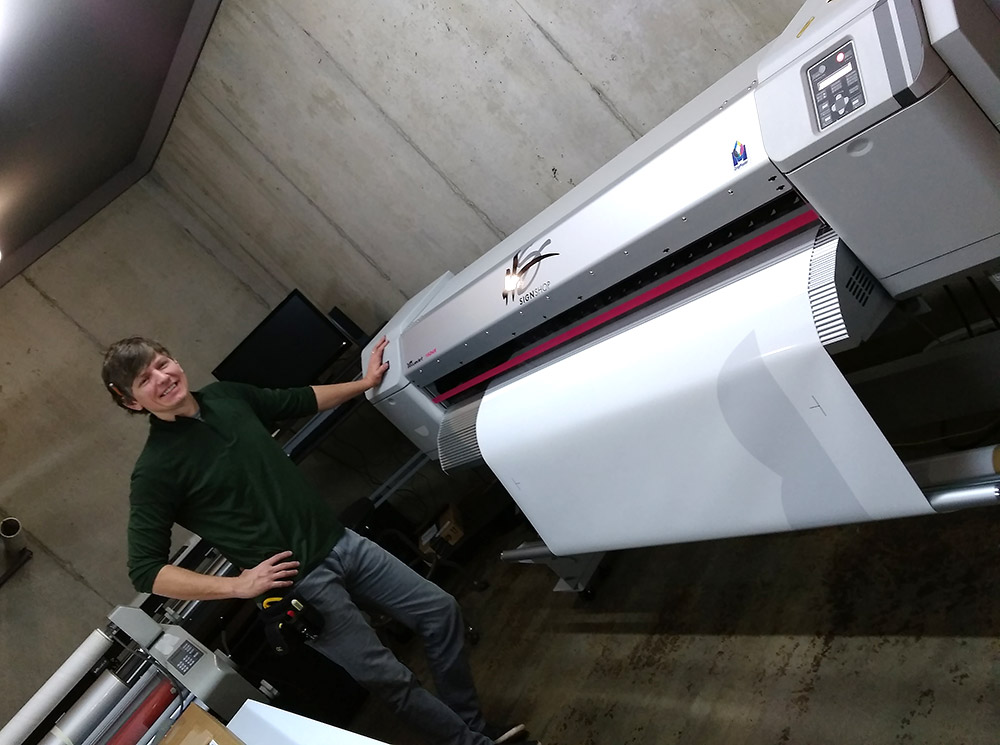 Eric Van Beek with large format printer