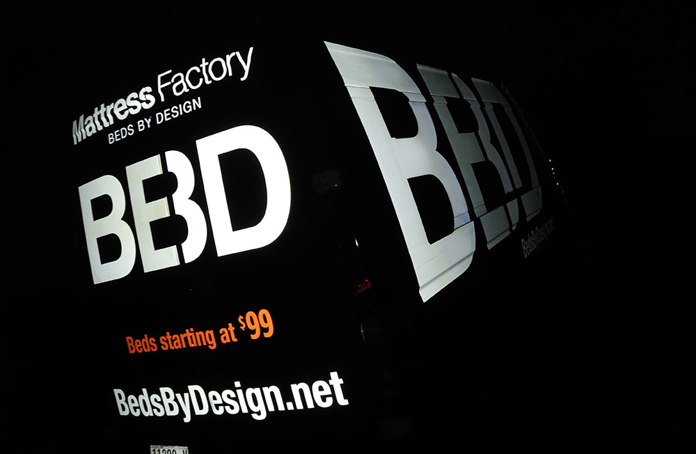 Beds by Design van wrap - refleciton at night