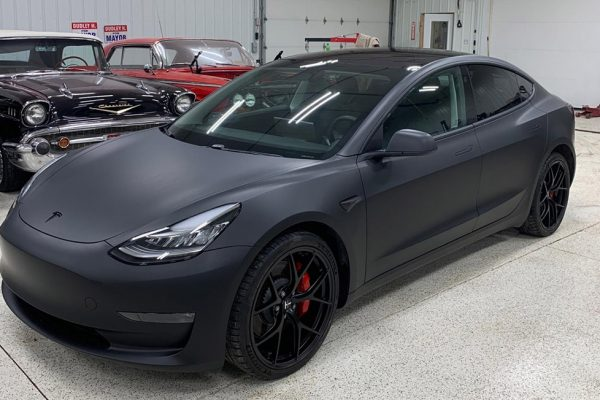 Tesla after vehicle wrap - now flat black!