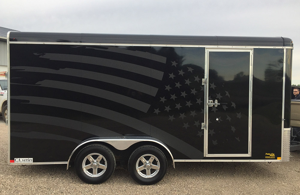 trailer with vinyl wrap of flag